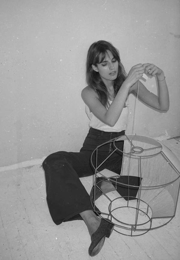 Kras at work on one of her hand-strung lamps, which were featured at the NYC Makers biennial at the Museum of Arts &Design in .Photograph byJody Rogac.