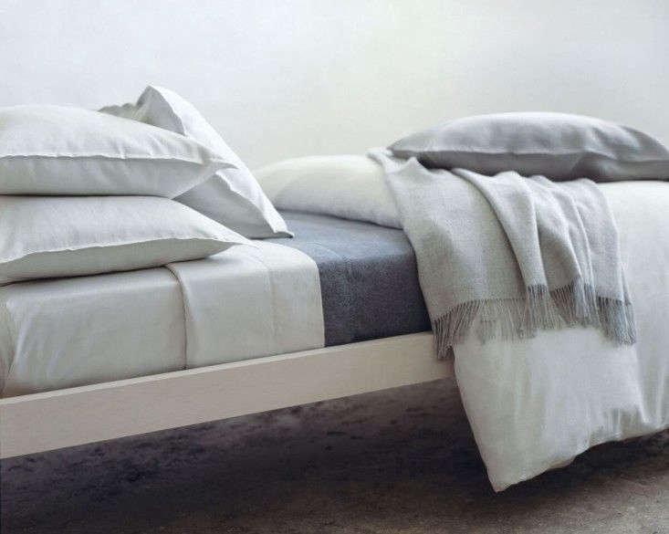 A clean, crisp bed made withArea Home Sheets.
