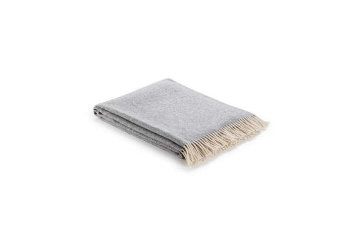 the arlo &jacob herringbone dove throw blanket is £85 (\$\107). another  21