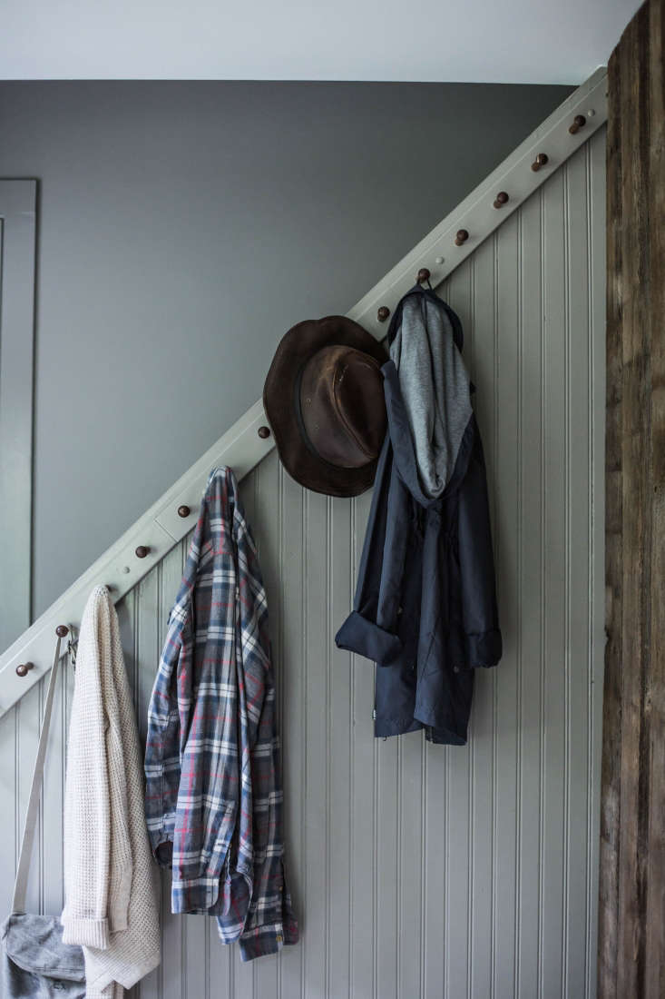 In a renovated New York farmhouse, Percy and Tara transformed a basic staircase into an architectural focal point (as well as a utilitarian coat rack) by installing beadboard paneling and simple Shaker hooks. (See: A Country House Reinvented by Jersey Ice Cream Co.) Photograph by Beth Kirby of Local Milk.