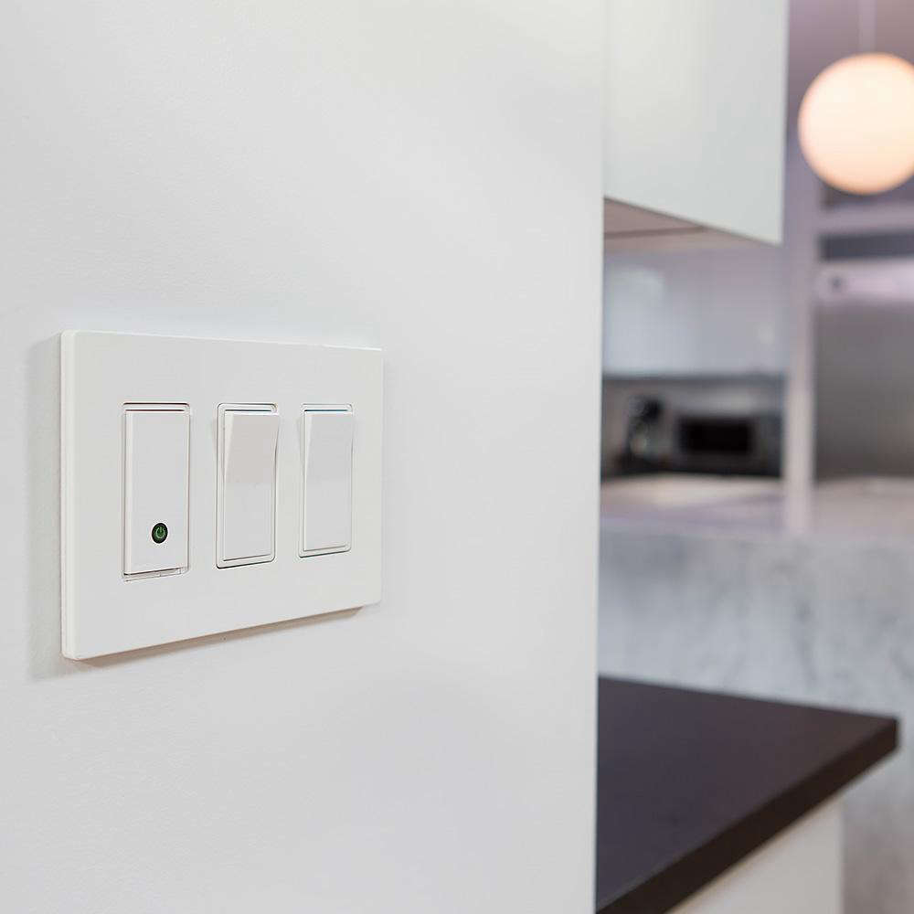 For hands-free dimmers, consider investing in a smart model, like the Belkin Wemo Wireless Light Control Switch, shown here; seeRemodeling src=