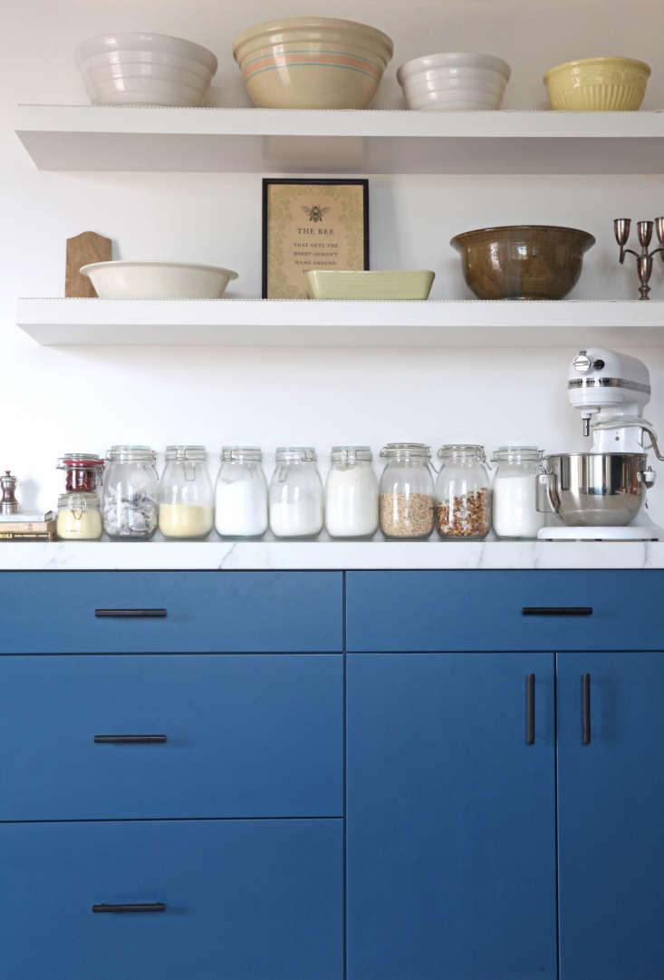 blue pantry kitchen shelves white bowls dry storage