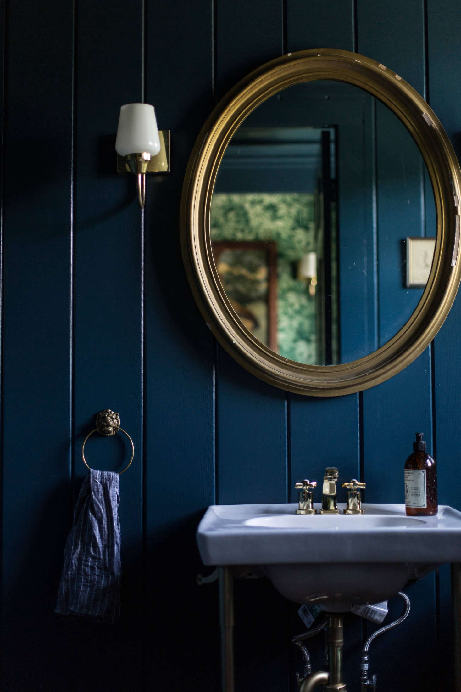 Painted a deep indigo, rustic V-groove suddenly takes on a more glamorous air. (See: A Country House Reinvented by Jersey Ice Cream Co.) Photograph by Beth Kirby of Local Milk.