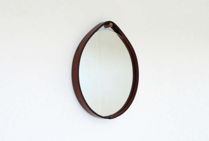 The Hang Mirror by Portland, Oregon–based designer Brendon Farrell is made from hand-stitched American bridle leather with a turned oak (shown) or unfinished brass wall hanger and is available in three sizes; starting at $loading=