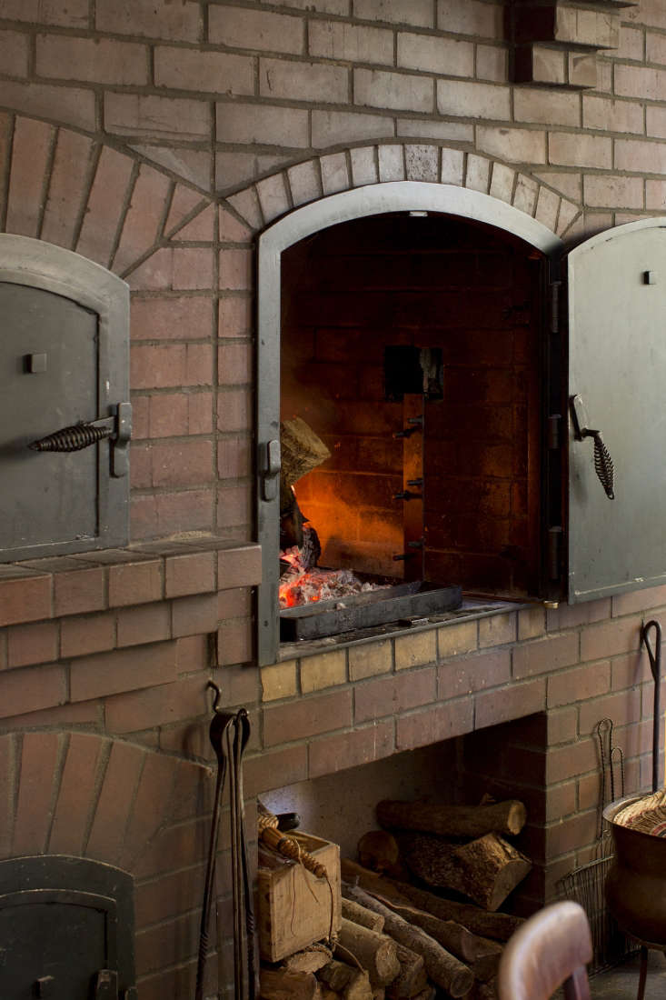 a wood fired brick oven in the open kitchen/dining room of alice waters&#8\ 10