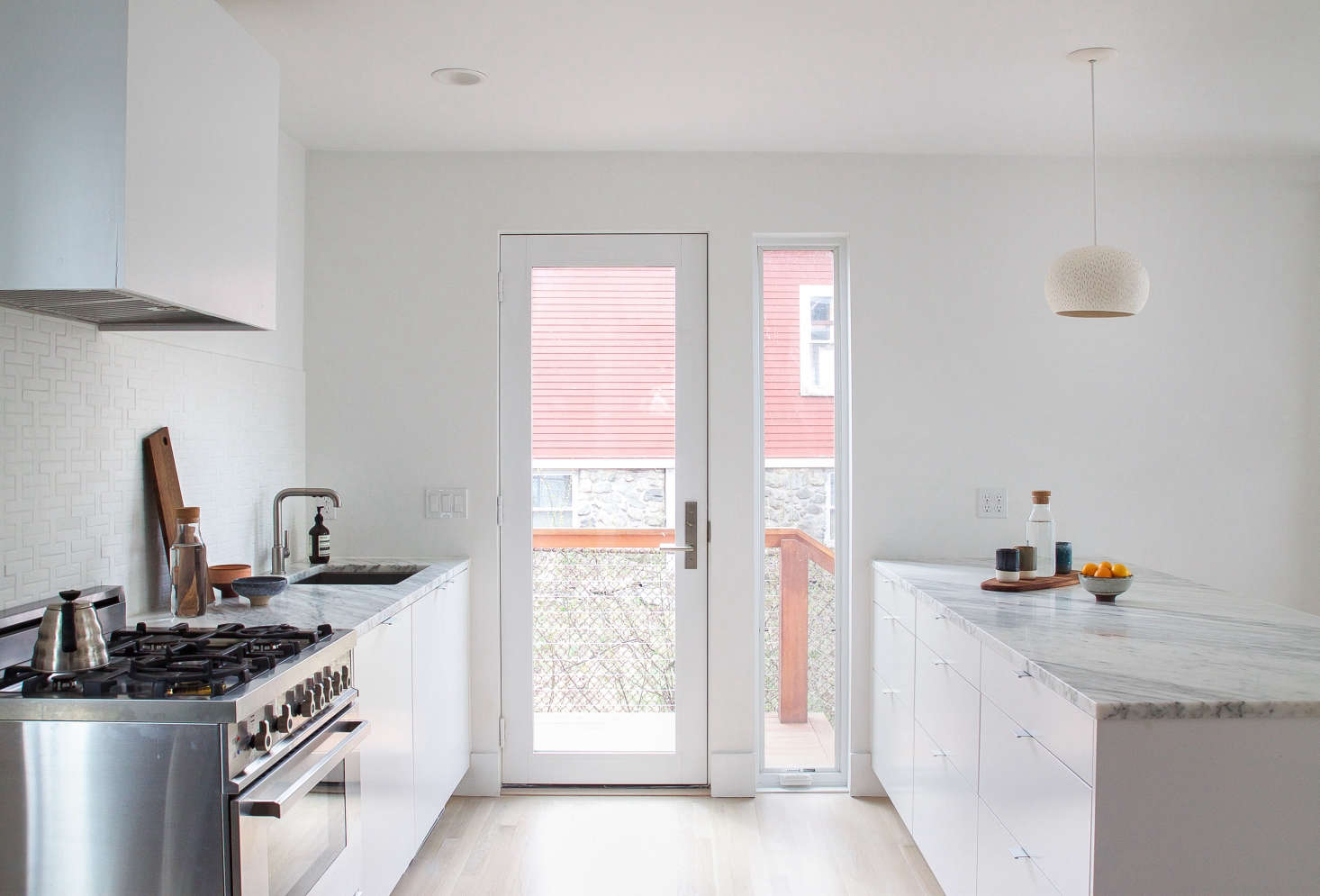 A coat ofBenjamin Moore Super White Paintin matte reflects light and brightens a previously dark Boston kitchen. Photograph by Justine Hand for Remodelista, fromReader Rehab: A Boston Kitchen Embraces the Light.