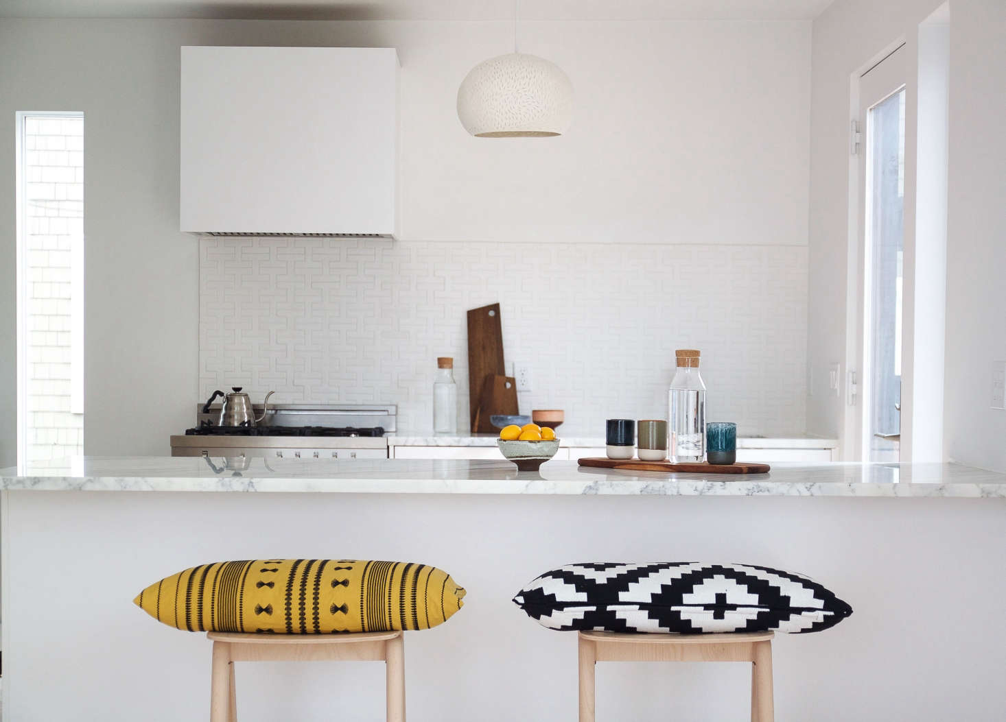 Subtle splashes of color saved the crisp, clean space from becoming too stark.