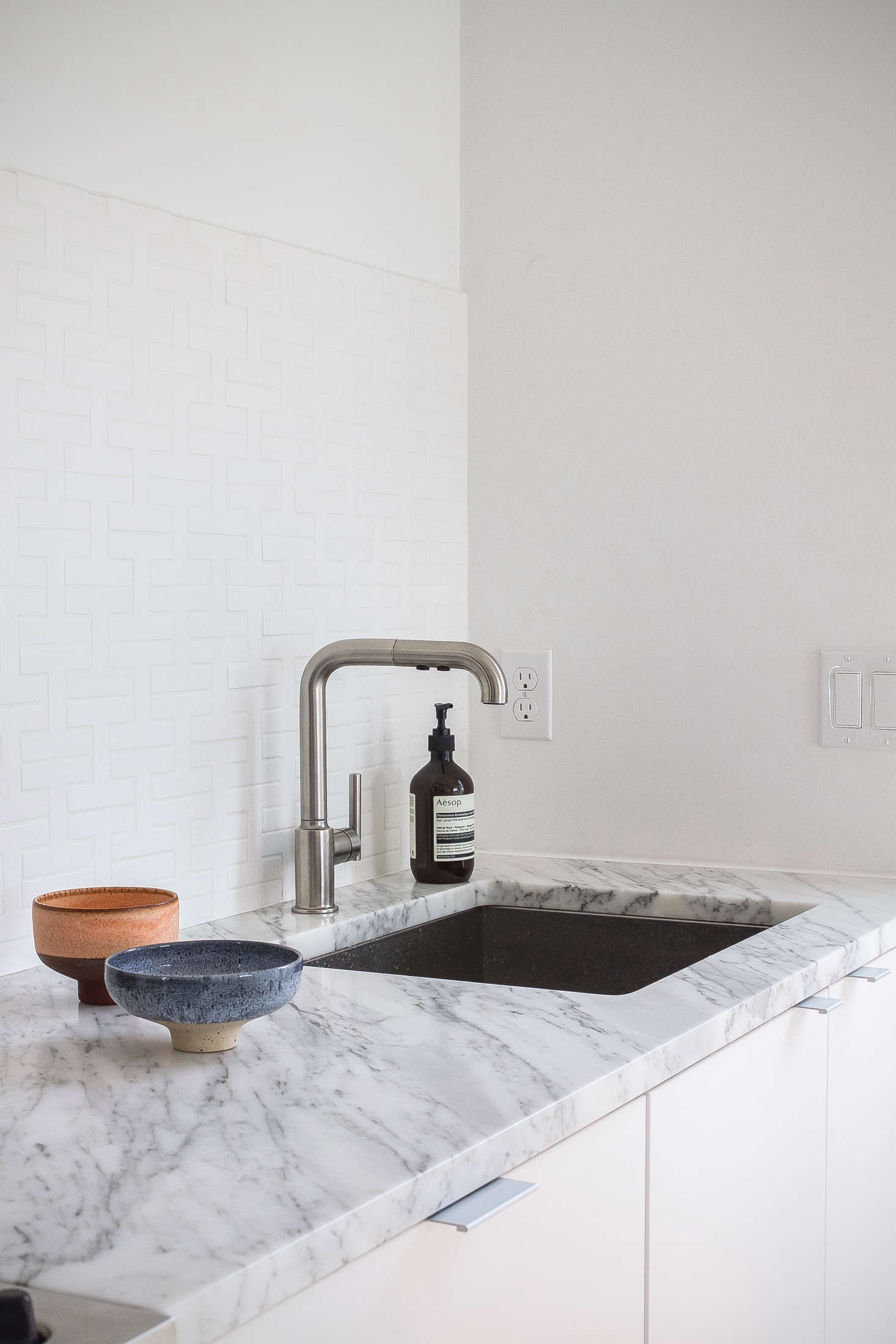 To complement their recessed sink, the couple selected Kohler&#8