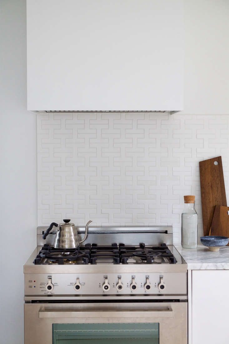 Splurges included aBertazzoni Pro-Series 30-Inch Gas Range; $3,350. Disguising another Bertazzoni hood, the contractor built a custom box of simple plywood. Painted the same white as the walls, it blends seamlessly into the space.