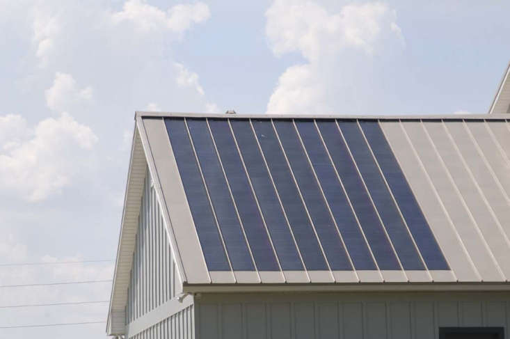 Photovoltaic (PV) panels integrated into a standing seam metal roof. Photograph via Fabral.