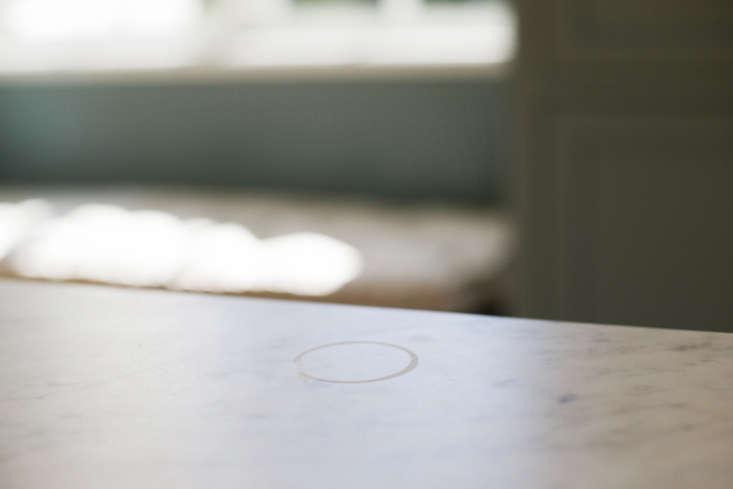 A ring markon the Calacatta marble countertops.