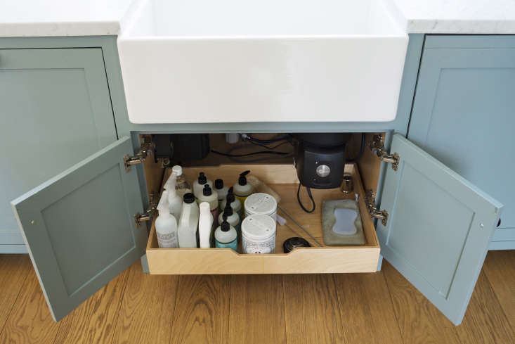 An under-sink pullout drawer provides storage space for cleaning essentials.