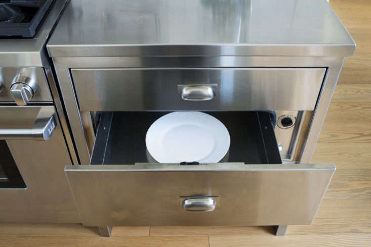 A stainless steel warming drawer.