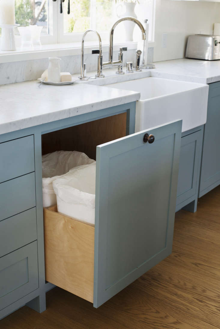 Trash and recycling bins are hidden in a single pullout cabinet.