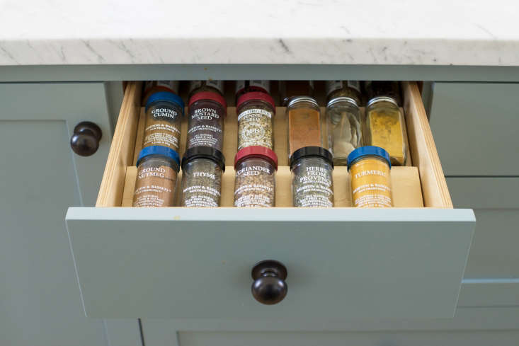 A drawer with built-in spice compartments.
