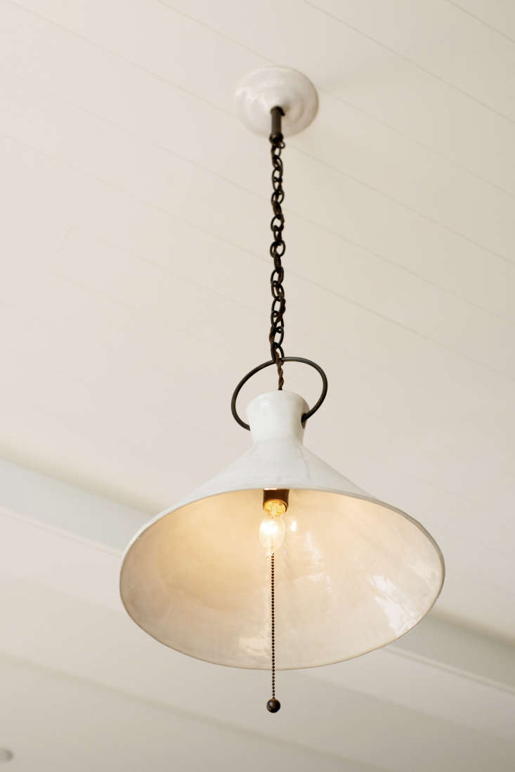 One of a pair ofhandmadeCeramic Page Pendant Lightsfrom BDDW by Philadelphia artist Natalie Page, which hang above the kitchen island.