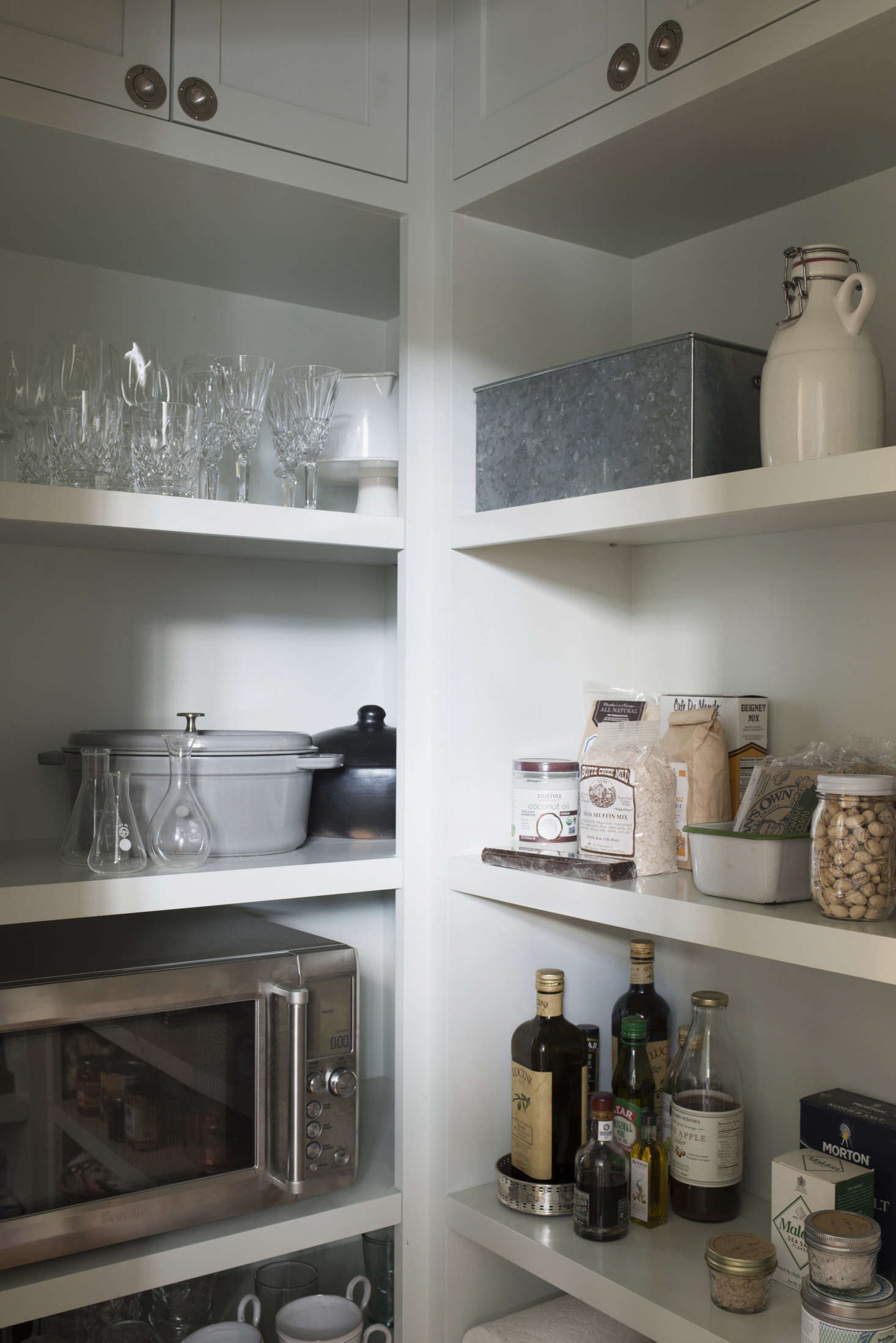 A freestanding microwave powered by a built-in outlet in a kitchen pantry designed by Ken Linsteadt in Mill Valley, California. Photograph by Andres Gonzalez fromKitchen of the Week: A New-Build Kitchen in Mill Valley, CA, the Six-Month Check-Up.