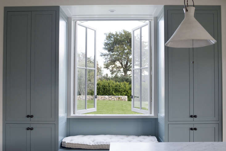 double casement windows open the kitchen to the backyard and lawn. the custom c 22