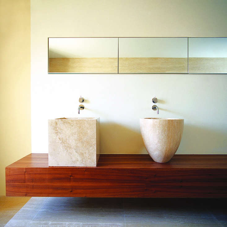 For a minimalist bath in Mayfair, London, UK architect Gavin Jackson commissioned a pair of washbasins cut from travertine by cathedral stone masons. Photograph by Warren Smith, courtesy of Gavin Jackson.