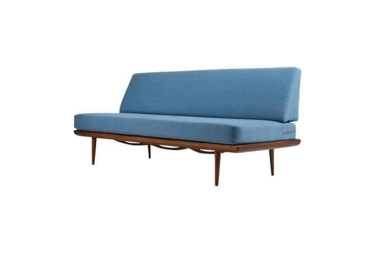 The Peter Hvidt & Orla Mølgaard Nielsen daybed, a flea market find, was given a facelift: The backboard was removed and the fabric reupholstered by Brooklyn interiors firm George & Martha. A similar version with blue fabric is the Nielsen Daybed on loading=