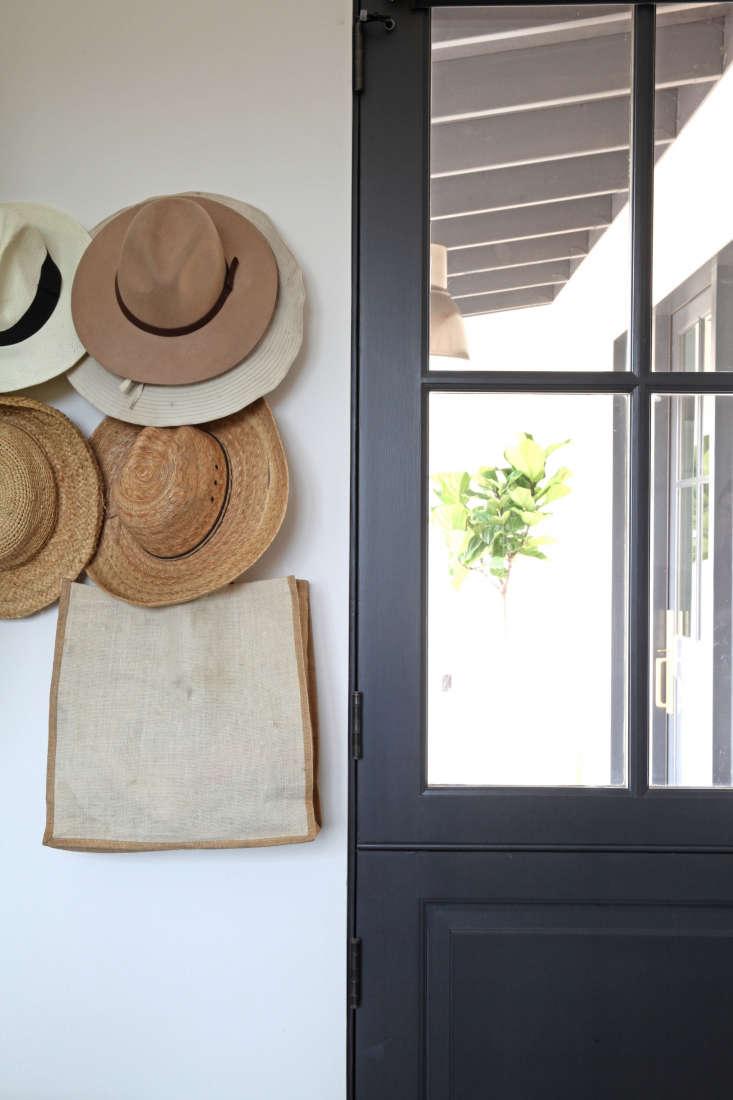 hats hanging on storage hooks black dutch door