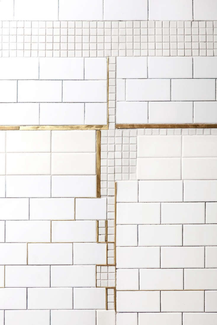 A patched subway tile wall inBauhaus on the Bowery: De Maria Cafe in NYC. Photograph by Heidi&#8