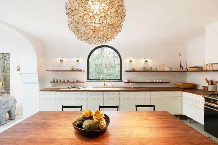 A glamorous L-shaped kitchen belonging to jewelry designer Irene Neuwirth designed for her by Commune. SeeKitchen of the Week: Irene Neuwirth's Glamorous LA Kitchen by Communefor more.
