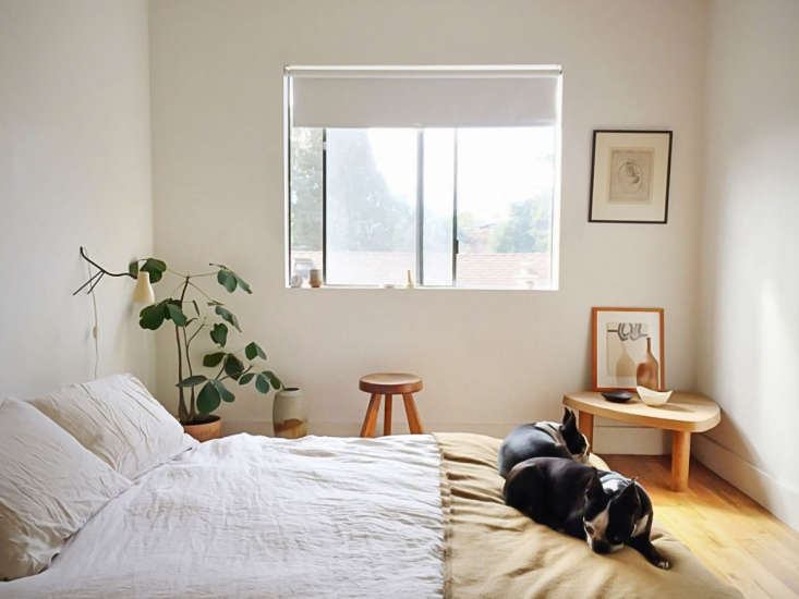 In the minimal bedroom, the couple&#8