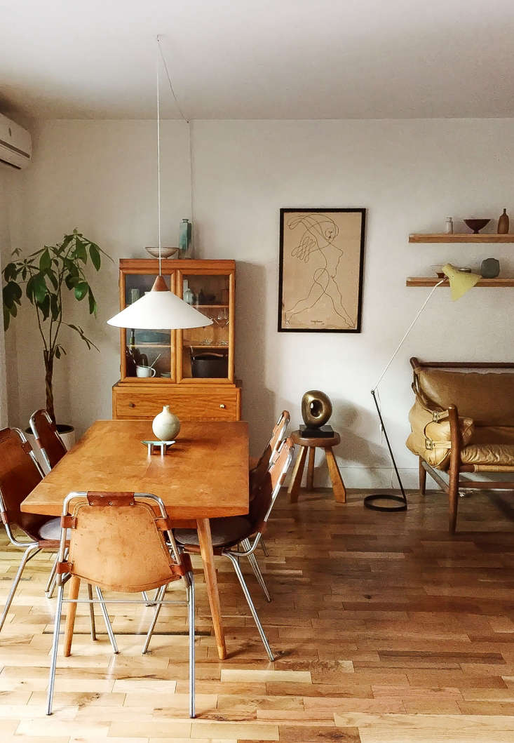 surrounding a \1950s george nakashima for knoll table is a set of charlotte per 13