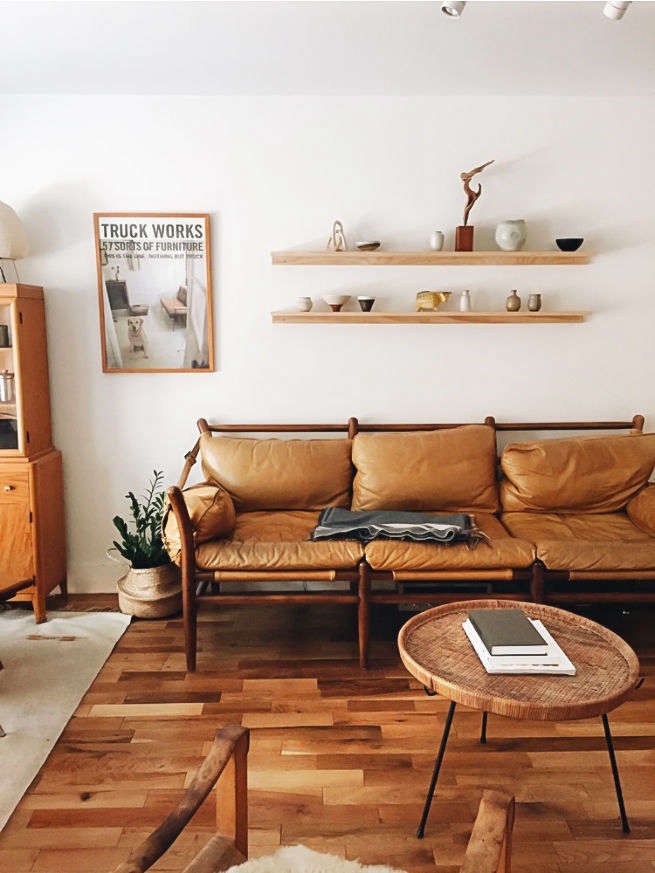 kirill and alysha&#8\2\17;s living room centers around a vintage leather so 9