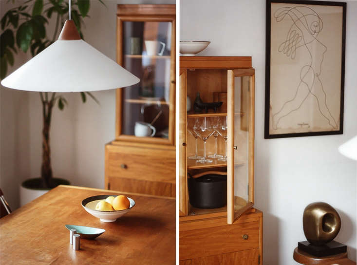 Midcentury modern details in the dining room feature a pendant lamp made in Sweden, as well as a Danish hutch, a 56 drawing by Jean Negulesco, and an unidentified 50ssculpture.