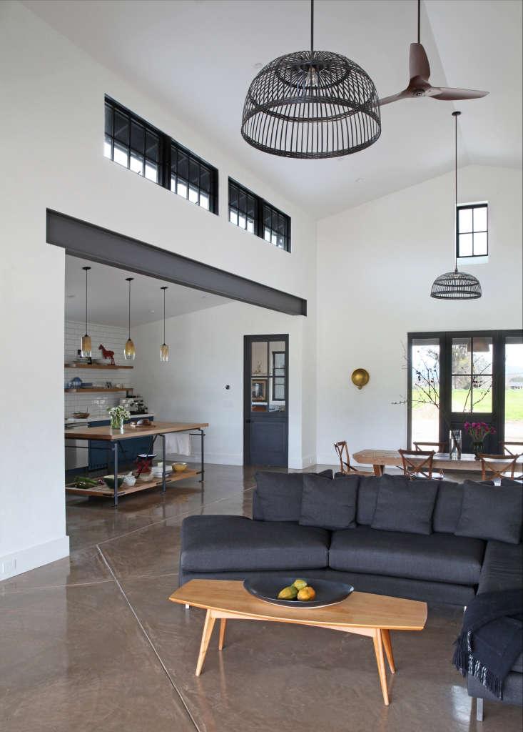 living room concrete floors gray sofa black basket pendants