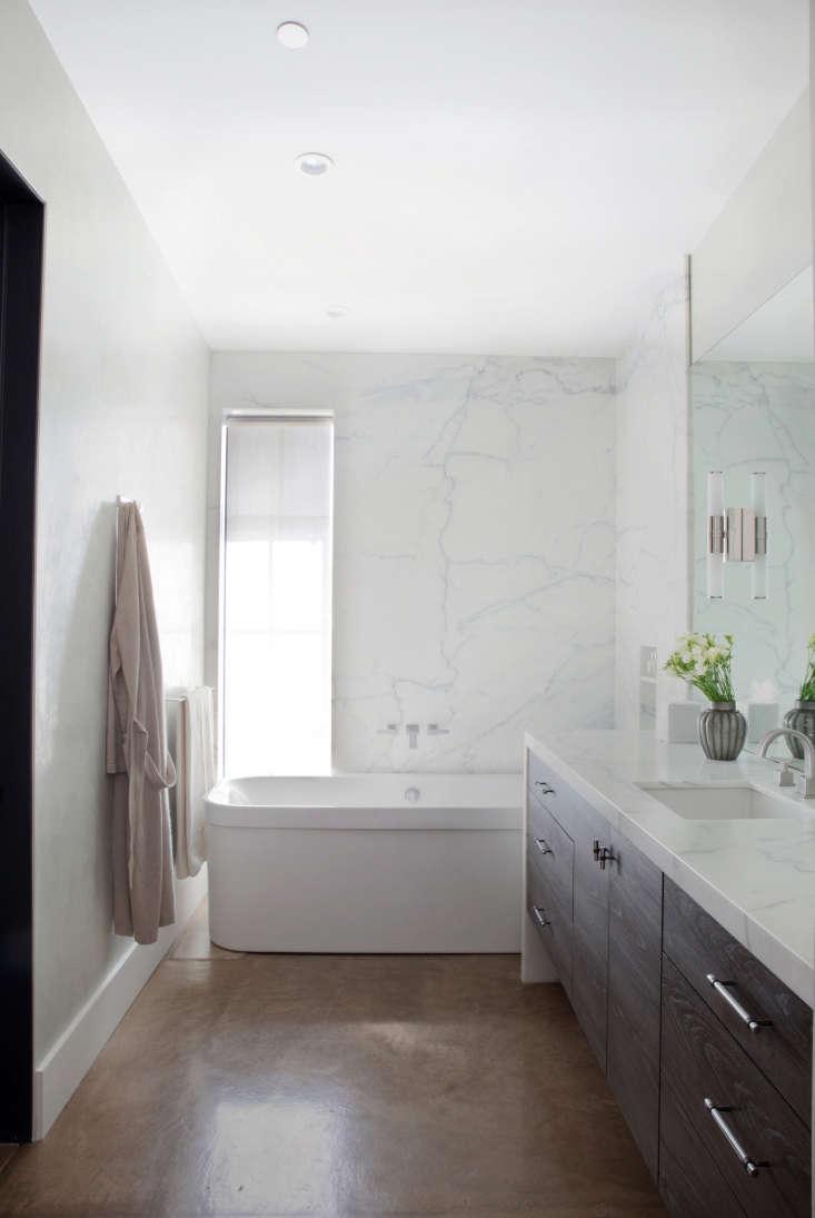 marble walls concrete floors master bath white