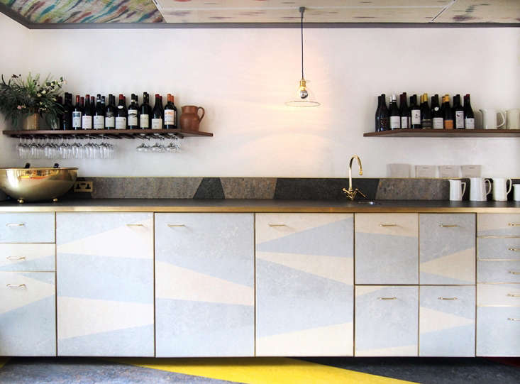 The kitchen unit has a linoleum-clad countertop and color-blocked cabinet fronts.Photo by Anabel Navarro Llorens.