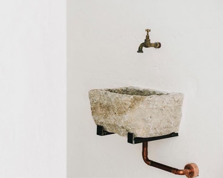 A stone sink at Masseria Moroseta in Puglia, Italy.