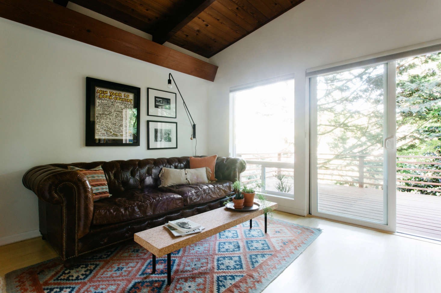 The homeowners brought the tufted leather sofa with them from their previous home, a Portland craftsman. Aboveit hangsaPotence Style Otis Lamp from One Forty Three.