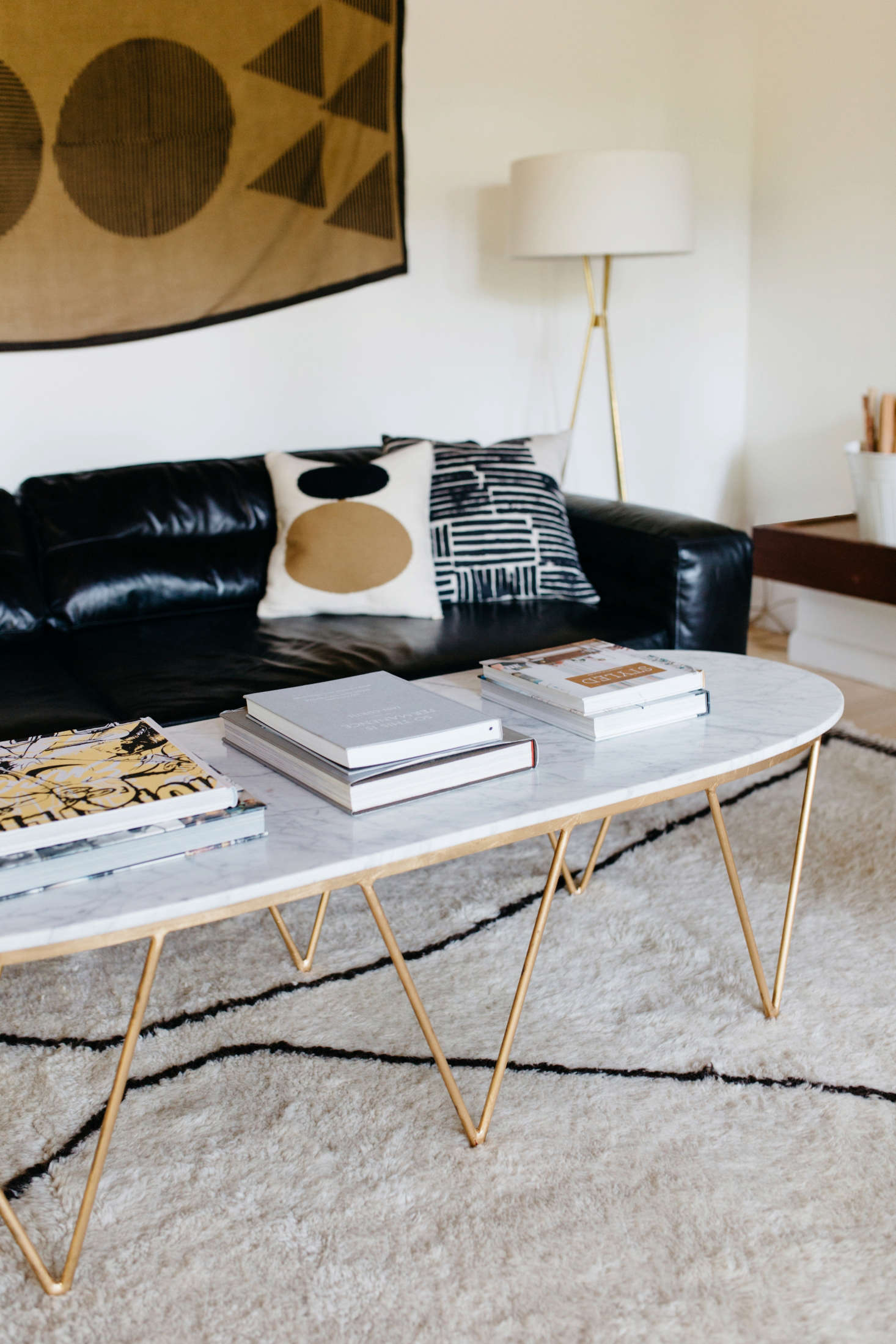 The marble and brass coffee table is fromRejuvenation in Portland.