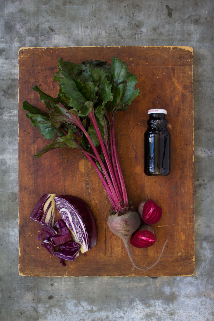 The team skippedthe artificial dye and opted for beets, grape juice, and red cabbage instead. (The worn wood cutting board and zinc table are from Prop Workshop in NYC.)