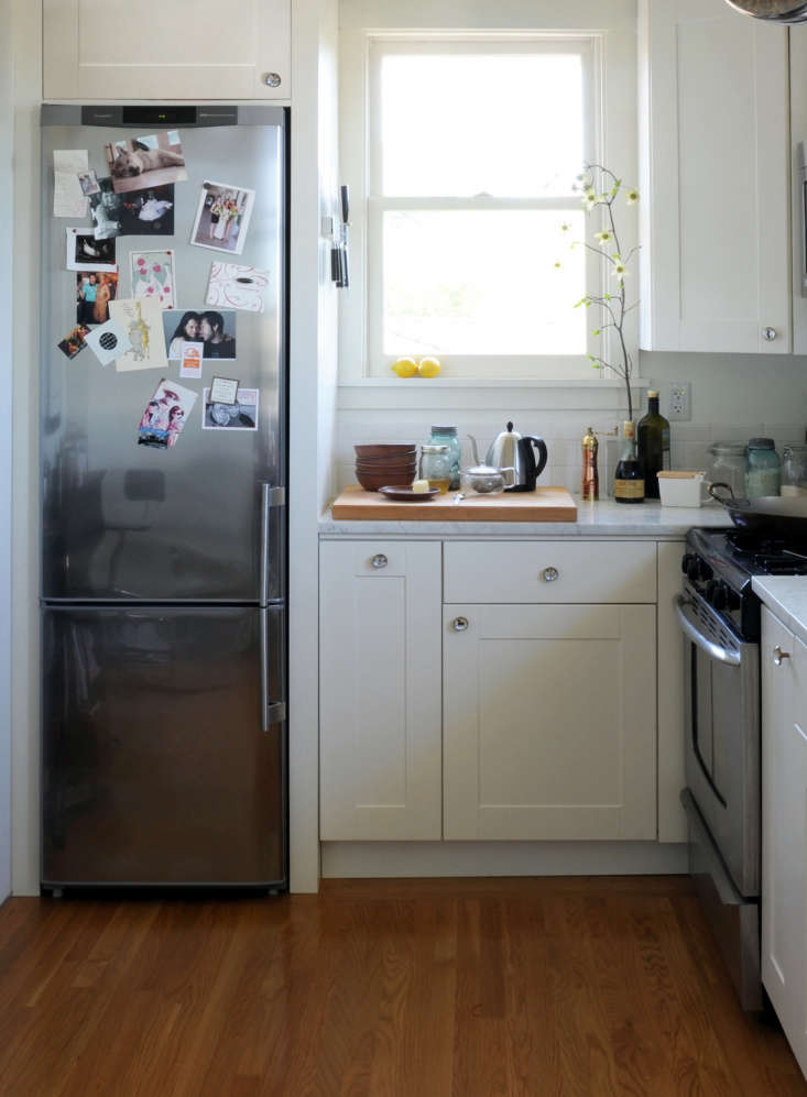 A tiny kitchen by Ore Studios has a refrigerator that measures a mere  inches wide. See more at 5 Favorites: Skinny Refrigerators.