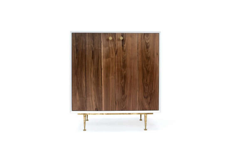 The Cincinnati A Cabinet has a lacquered frame, walnut front, and brass handles and feet; $loading=