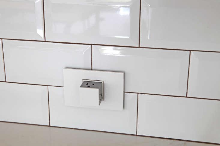 pop out white electrical outlet tile backsplash kitchen