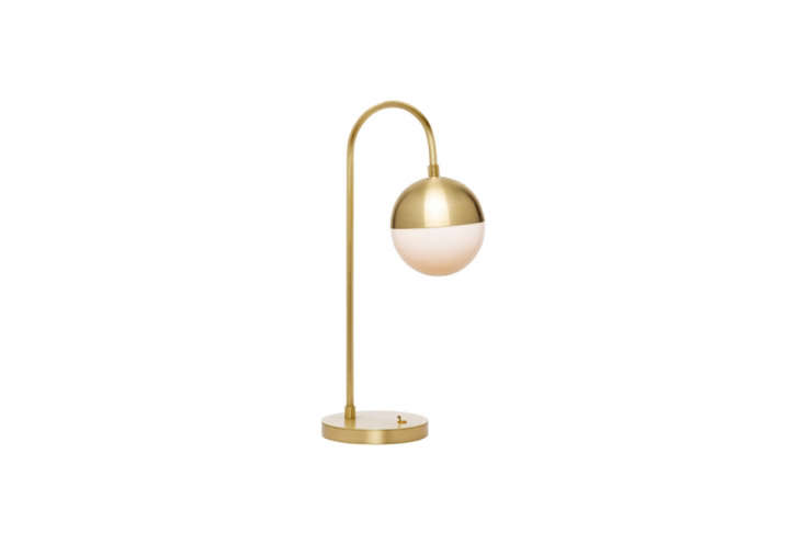The Cedar & Moss Table Lamp has a brushed brass finish similar to the table lamp seen on the cabinet. It&#8
