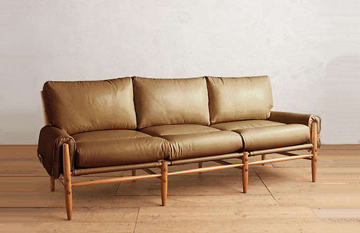 Of similar design: The Premium Leather Rhys Sofa, shown here in caramel, is $5,598 from Anthropologie. N.B.: The sofa is custom-made and will be available to ship on May .