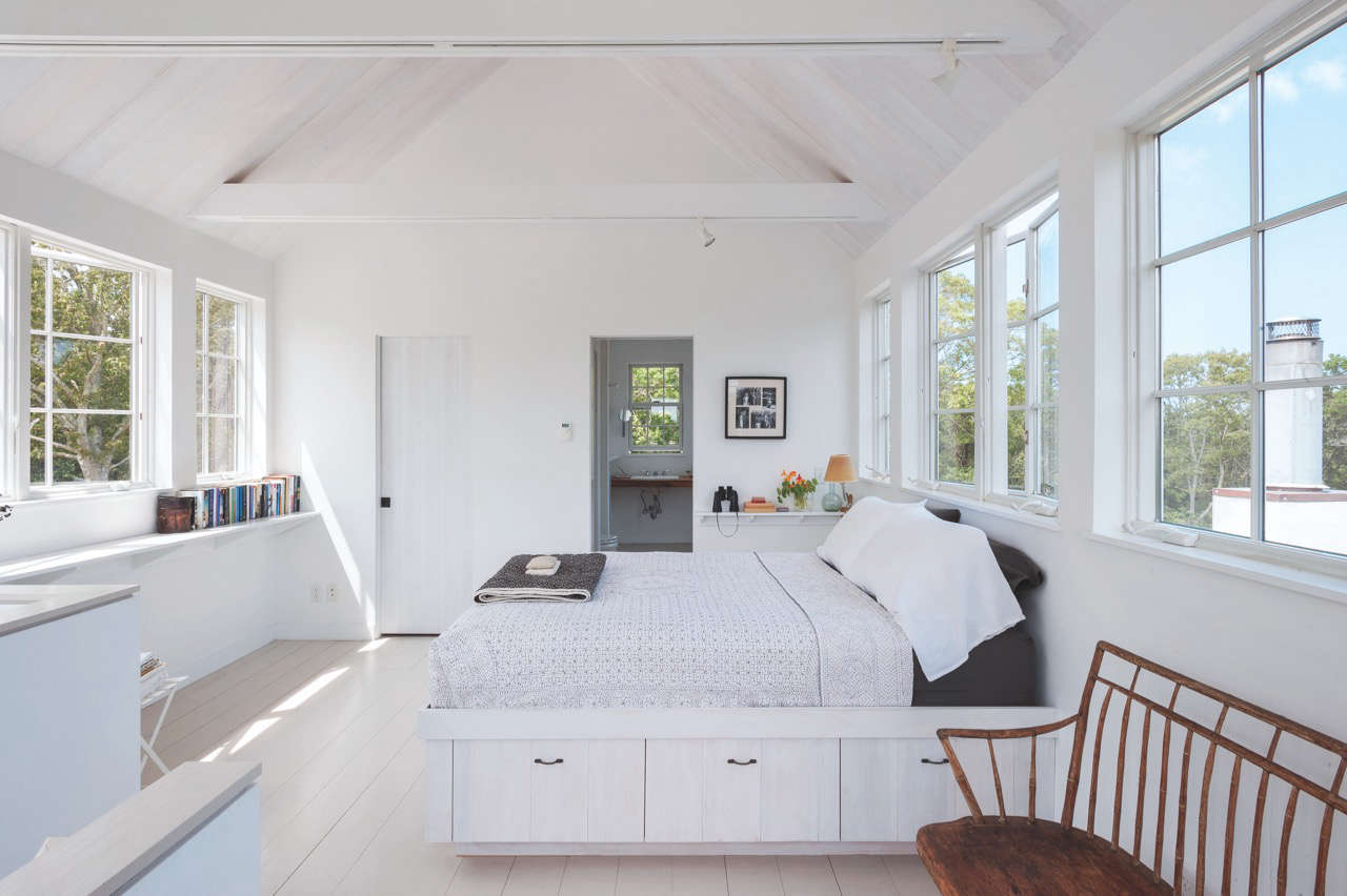 Even maximalists find it easier to sleep in a room stripped of excess stuff. This storage bed on Cape Cod doubles as a dresser. For space-enlarging approaches, see Justine&#8