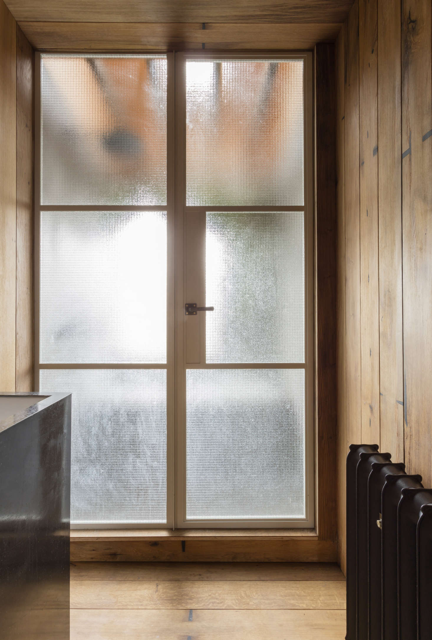 Architect Simon Astridge used fumed oak boards on the floor (and walls and ceiling) of his own London bathroom. SeeBathroom of the Week: A Japanese-Style Bath in London, Greenery Included for more.