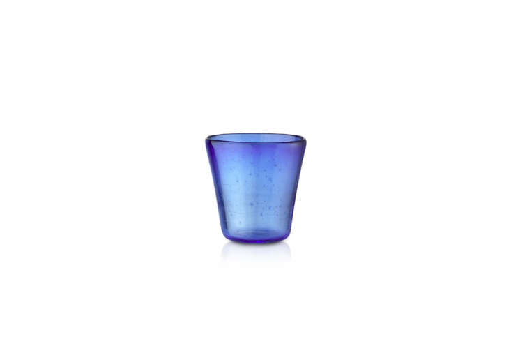 the handblown glass votive in cobalt blue can be used as a votive or a glass, a 12