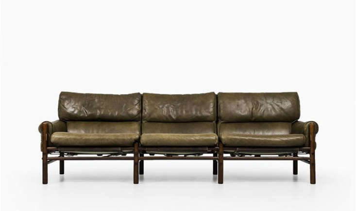 The Kontiki Sofa by Swedish designer Arne Norell has a beech frame with leather upholstery; this version is currently available for $,loading=