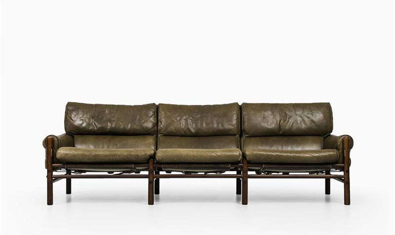 The Kontiki Sofa by Swedish designer Arne Norell has a beech frame with leather upholstery; this version is currently available for $,src=