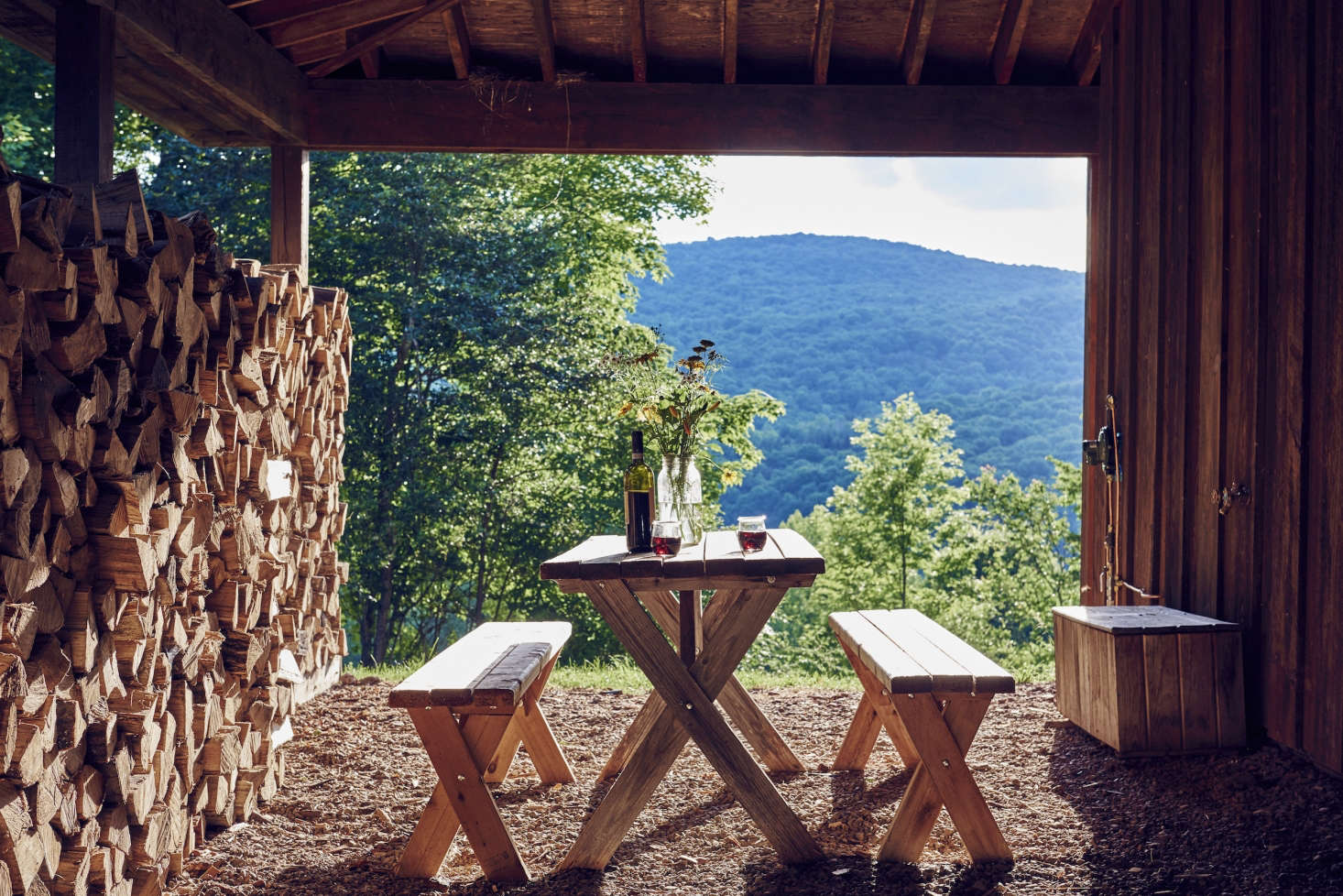 Ahandcrafted picnic table overlooking thevalleyis well-suited to an evening glass of wine.