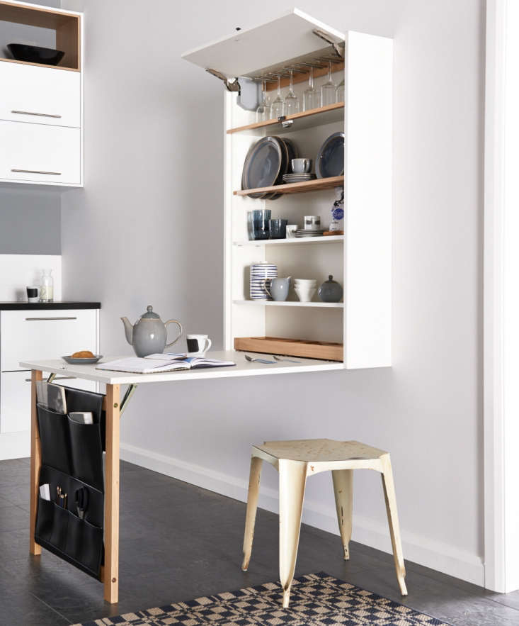 The Table Plus from UK-based Magnet Kitchens offers an extra work or dining surface and includes storage space. The leather pockets are handy for stashing mail and magazines.